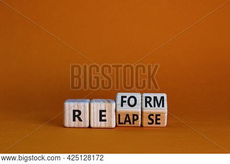 Relapse Or Reform Symbol. Turned Wooden Cubes And Changed The Word 'relapse' To 'reform'. Beautiful