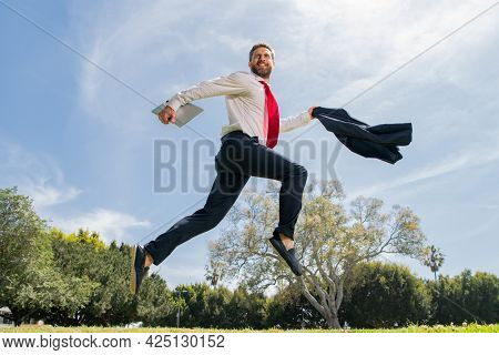 Excited Business Man Running Fast, Racing And Jumping. Portrait Of Successful Businessman. Amazed Ma