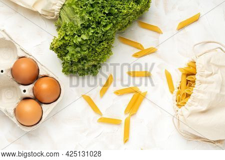 Eggs, Salat And Pasta In Eco Package On White Cement Background.zero Waste Cconcept. Package-free Fo