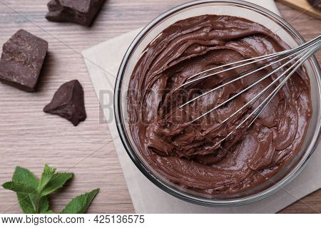 Whipping Chocolate Cream With Balloon Whisk On Wooden Table, Flat Lay