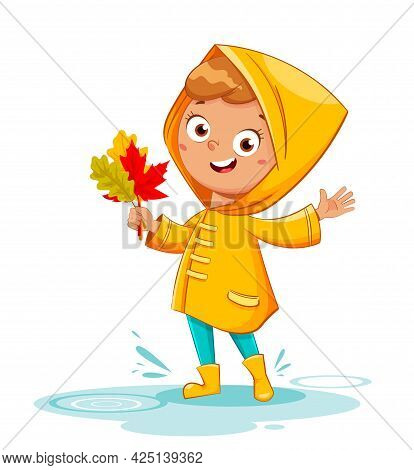 Happy Funny Child In Yellow Raincoat And Rubber Boots Holding Leaves, Rainy Autumn. Cheerful Girl Ca