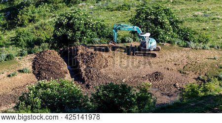 Monte Baldo, Italy - 06 25 2021: A Digger In The Mountains.