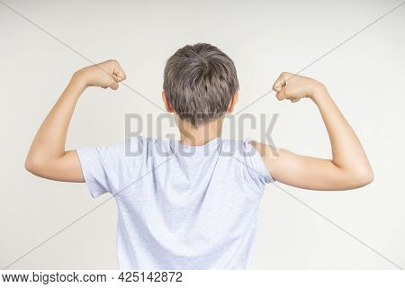 Teenage Boy With Bandage Plaster On His Arm Makes Fist And Flexes Her Bicep After Vaccination. Injec