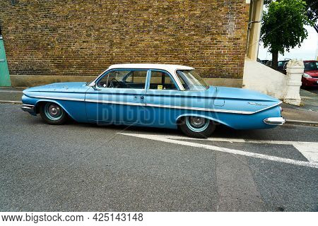 Ramsgate, United Kingdom - June 10, 2021: A Blue 1961 4 Door Chevrolet Bel Air From The Rear. A Blue