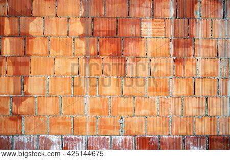Hand made brick wall made from narrow bricks, abstract background texture. Red grunge brick in the wall with gray putty. Brick screen saver. Empty brick wall