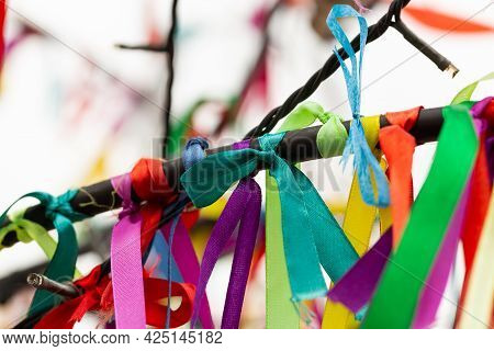 Wish Tree Branches With Colorful Ribbons. Ritual Tapes On Wishing Tree. Many Multi-colored Ribbons F