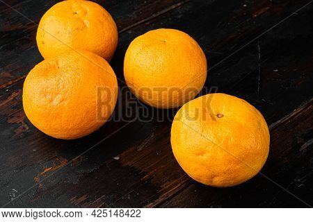 Organic Clementine Or Tangerine Set, On Old Dark  Wooden Table Background