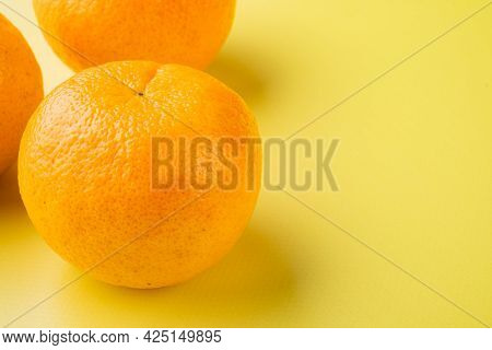 Organic Clementine Or Tangerine Set, On Yellow Textured Summer Background, With Copy Space For Text