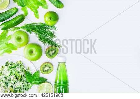 Fresh Green Vegetables, Fruits And Green Smoothie In Bottle. Top View With Copy Space. Detox, Diet O