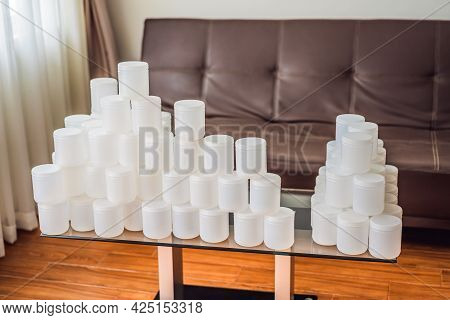 A Huge Amount Of Plastic Food Jars. Excessive Consumption Of Plastic. Reduce, Reuse, Recycle