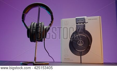 Russia, Moscow - May 5, 2021: New Headphones From Audio Company. Action. Stylish Headphones With Hig