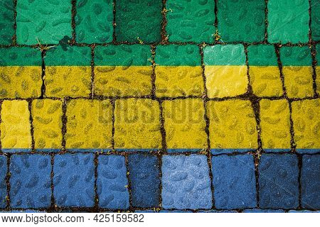 National Flag Of Gabon On Stone  Wall Background. Flag  Banner On  Stone Texture Background.
