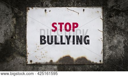 Stop Bullying, Words On A Grunge Metal Board On Wall.