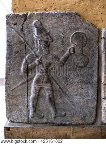 Berlin, Germany - 18 September 2019: Part of Babylonian bas relief in Berlin Pergamon museum in Germany. Historical ancient art of east religion and civilization.