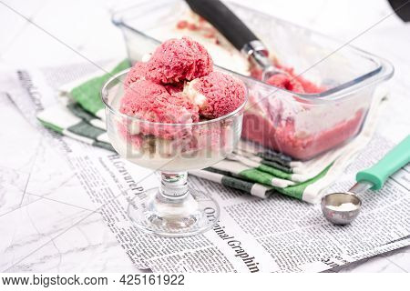 Strawberry Frozen Yogurt In Glass Bowl, Ice Cream Balls, Container With Homemade Sundae