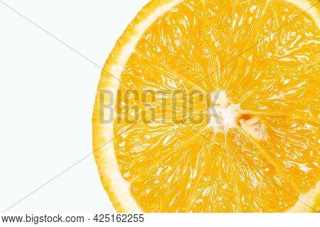 Orange Macro Shot Half Isolated On White Background. Orange On White. Orange With Clipping Path