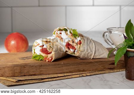 Homemade Shawarma Or Burrito Or Chicken Roll With Vegetables And Sauce