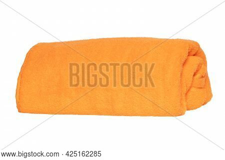 Towels Isolated. Closeup Of A Rolled Up Yellow Soft Terry Bath Towel Isolated On A White Background.