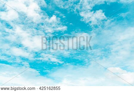 White Fluffy Clouds On Blue Sky. Soft Touch Feeling Like Cotton. White Puffy Cloudscape. Beauty In N