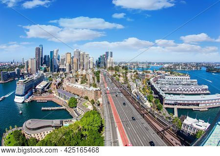 The famous Sydney Harbor and ocean port. Sidney is the largest and oldest city in Australia and the capital of New South Wales.