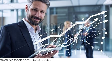Animation of financial data processing over businessman using tablet. global business, digital interface, technology and networking concept digitally generated video.