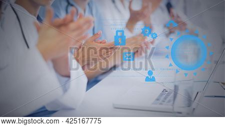 Composition of network of digital icons over doctors clapping. global medicine, digital interface, technology and networking concept digitally generated image.