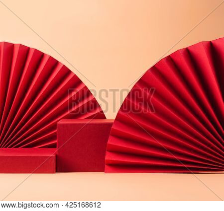 Abstract Fashion Podium For Advertising Cosmetics Products. Red Podium Paper Oriental Fan Pink Paste