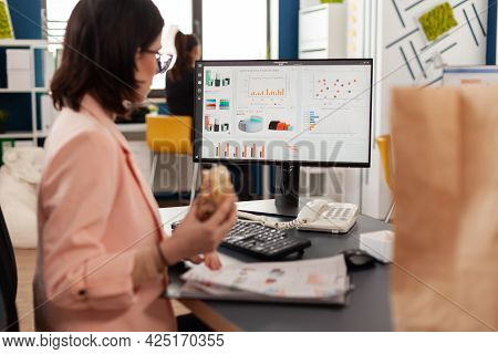 Businesswoman Eating Tasty Sandwich Having Meal Break Working In Business Company Office During Take