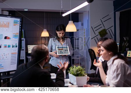 Overworked Workaholic Entrepreneur Woman Shwoing Marketing Graphs Using Tablet Overworking At Compan