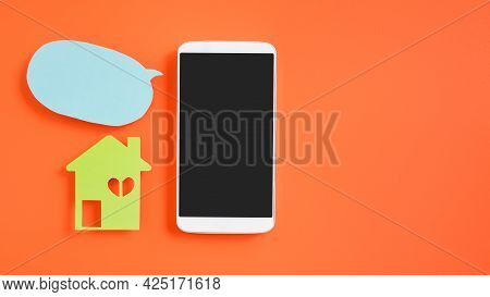 White Smartphone With Clipping Path On Touchscreen, Green House Paper Cut And Blue Bubble Speech Pap