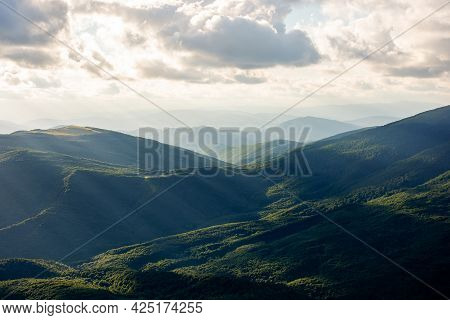 Dramatyc Mountain Landscape In Evening Light. Clouds Above The Ridge And Hills In Dappled Light. Won