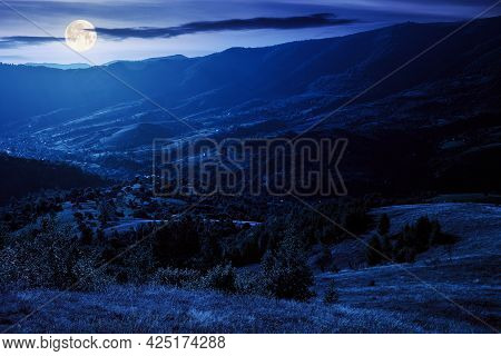 Rural Landscape At Night. Beautiful Countryside Scenery Of Carpathian Mountains In Full Moon Light.