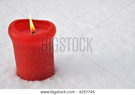 Red Candle In The Snow burning firmly poster