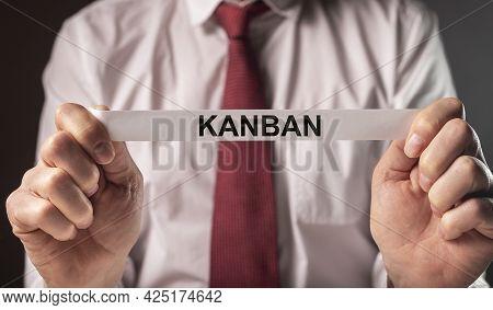 Kanban Or Lean Method In Management Concept. Word On Paper In Businessman Hands.