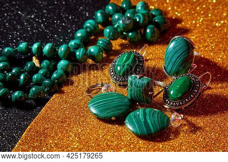 Jewelry From Green Malachite. Malachite Beads And Earrings In The Studio