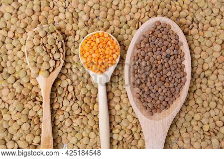 Uncooked Red Lentils Background Texture. The View From The Top. Healthy And Healthy Food