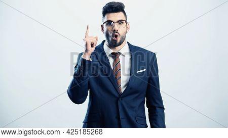 Astonished Businessman Showing Idea Gesture Isolated On White