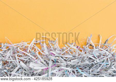 The Shredded Paper On Light Orange Background.