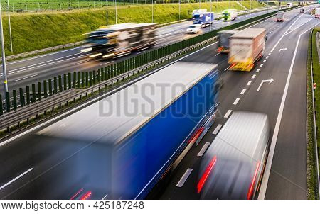 Trucks On Six Lane Controlled-access Highway In Poland