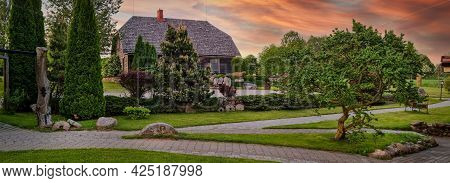 Beautiful Landscaped Garden In Front Of Old Wood House. Banner Copy Space
