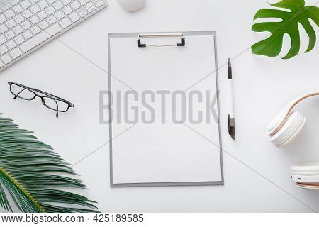 Mockup Empty Notes List On Workspace On White Office Table Desk. Home Freelance Work Space With Keyb