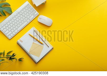 Office Desk Workspace On Bright Color Yellow Background. Office Table Work Space Layout With Compute