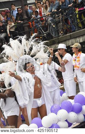 Amsterdam, Holland - August 04, 2012: People Celebrate The Gay Parade, Celebration On The Canals Of