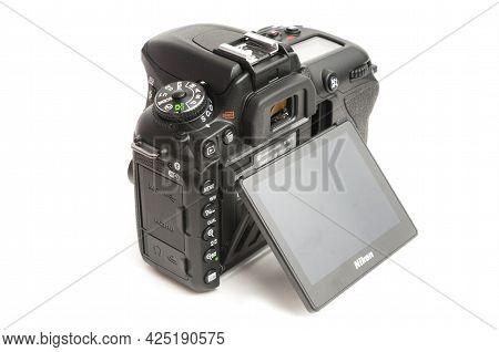 Carrara, Italy - June 26, 2021 - Rear View Of A D7500 Nikon Dslr Camera Body With Tilted Lcd Screen
