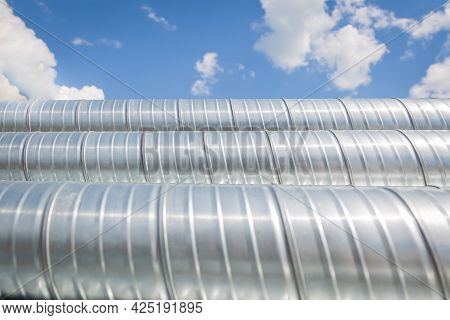 Ventilation Pipes Against The Blue Sky. Steel Pipes, Parts For The Construction Of Air Ducts For An
