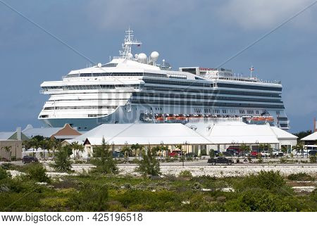 The View Of Of A Large Cruise Ship Moored Near Tourist Village On Grand Turk Island (turks And Caico