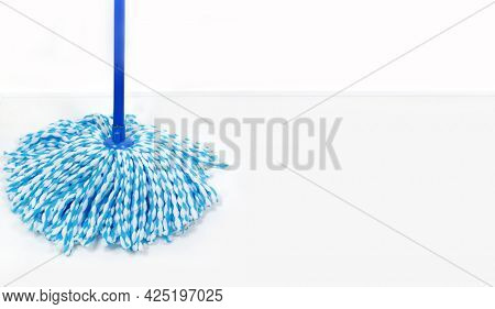 Rope mop in blue. Microfiber mop. House cleaning.