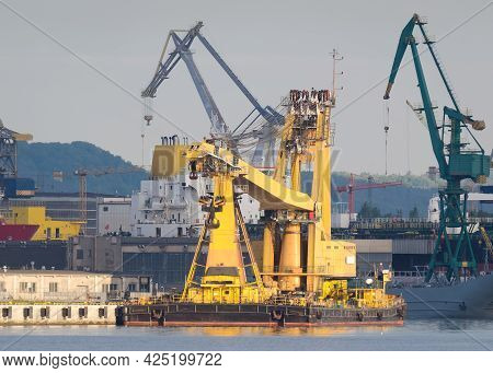 Crane Ship - A Specialized Yellow Machine Moored At The Quay Of Seaport