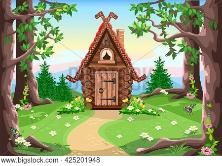 A Fairy Tale Hut Made Of Logs With Carved Trim On The Roof, A Chimney And A Horseshoe For Luck. Old