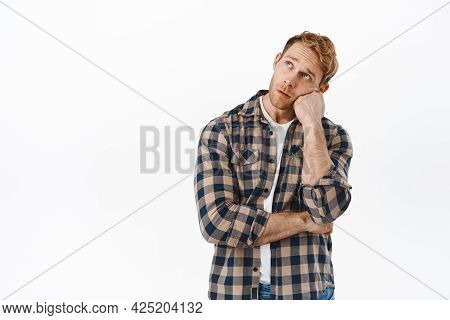 Bored Adult Man With Red Hair, Looking At Upper Left Corner With Indifferent Sad Face, Staring At So